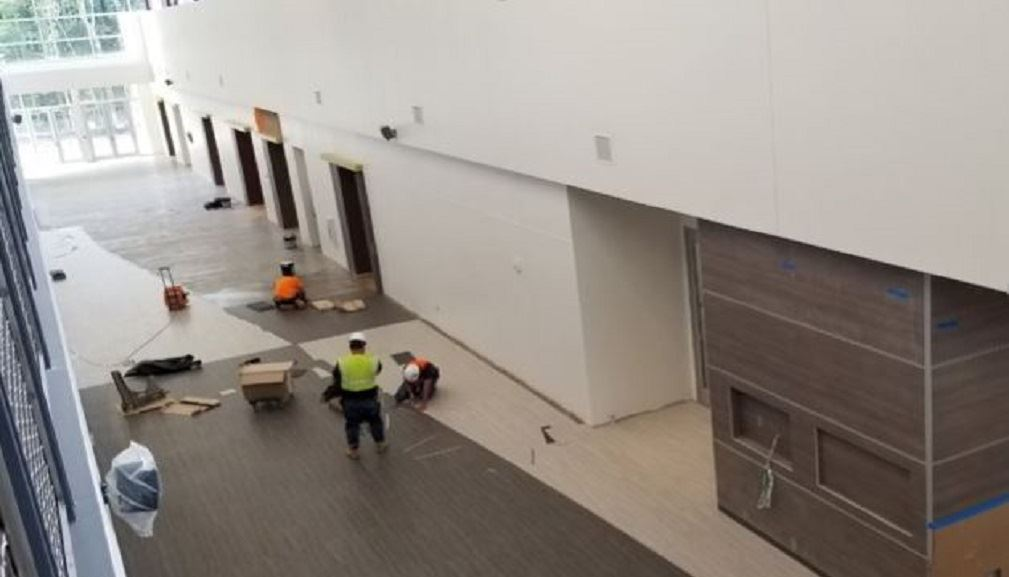 Installation of floor tile in the Lobby