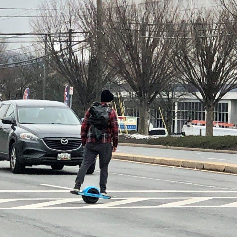 Pedestrian on motorized skateboard